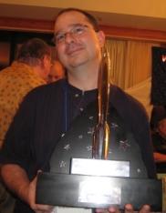 John and his Best Fan Writer Hugo award, it looks... pointy...